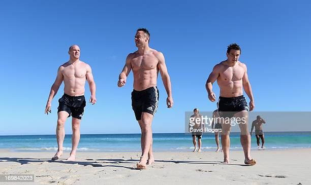 Paul O'Connell Tommy Bowe and Jonathan Davies walk out of the ocean during the British and Irish Lions swimming session at City Beach on June 3 2013...