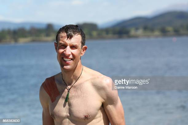 Paul Odlin of Christchurch Powernet takes a swim in Lake Te Anau during stage three from Riverton to Te Anau of the 2017 Tour of Southland on October...