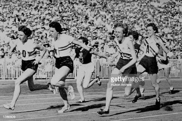 Paul of the British team hands over the batton to her team mate during the Olympis Games in Melbourne Australia Australia go on to claim the gold...