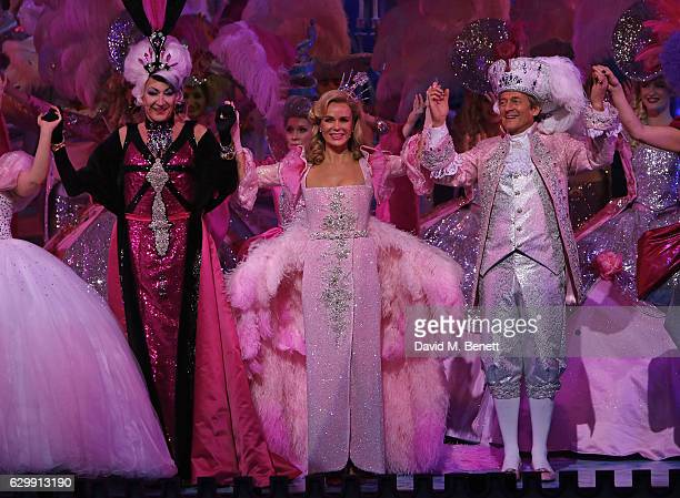 Paul O'Grady Amanda Holden and Nigel Havers boy at the curtain call during the Opening Night performance of 'Cinderella' at London Palladium on...