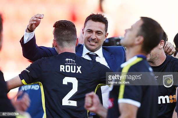 Paul Okon coach of the Central Coast Mariners celebrates with his players after the round five ALeague match between Adelaide United and the Central...