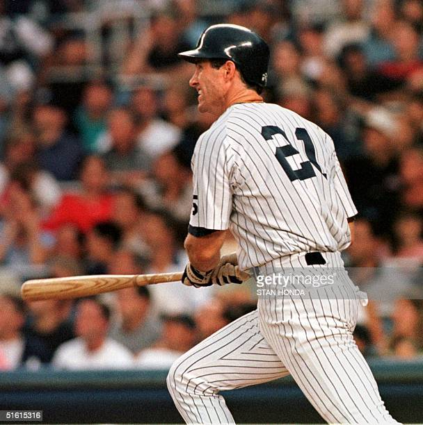 Paul O'Neill of the New York Yankees watches his solo home run off pitcher Dave Mlicki of the Detroit Tigers in the second inning of game at Yankee...