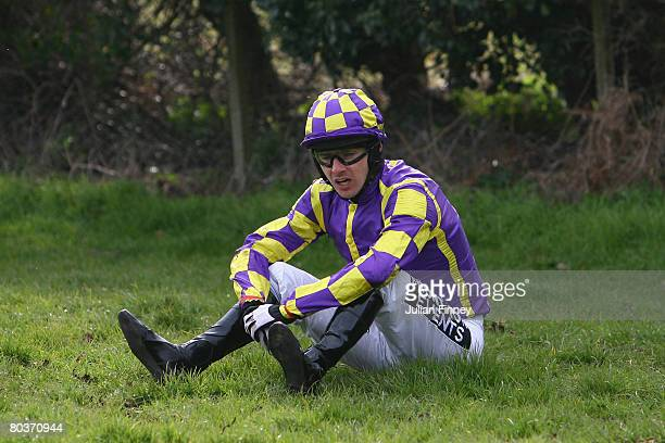 Paul O'Neill sits on the ground after falling from his mount The Preacher during The Hyder Consulting Ltd Selling Hurdle Raceat Fontwell Racecourse...