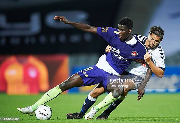 Paul Onuachu of FC Midtjylland and Alexander Juel Andersen of AGF Aarhus compete for the ball during the Danish Alka Superliga match between AGF...