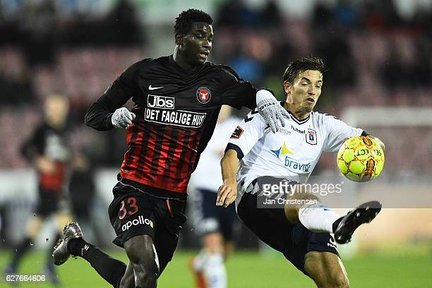 Paul Onuachu of FC Midtjylland and Alexander Juel Andersen of AGF Arhus compete for the ball during the Danish Alka Superliga match between FC...
