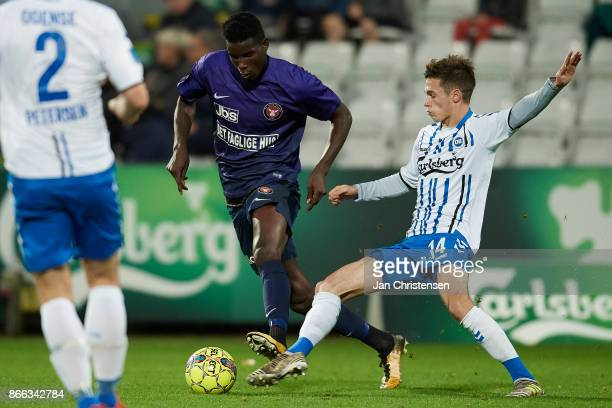 Paul Onuachu of FC Midtjylland and Jens Jakob Thomasen of OB Odense compete for the ball during compete for the ball during the Danish Cup DBU...