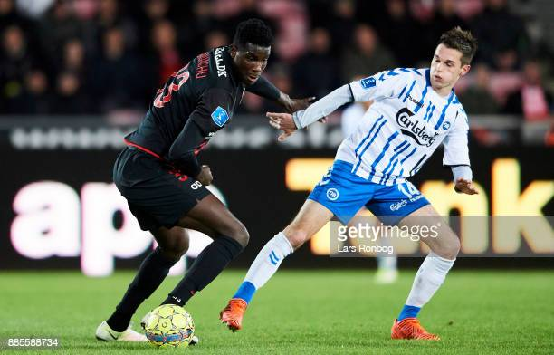 Paul Onuachu of FC Midtjylland and Jens Jakob Thomasen of OB Odense compete for the ball during the Danish Alka Superliga match between FC...