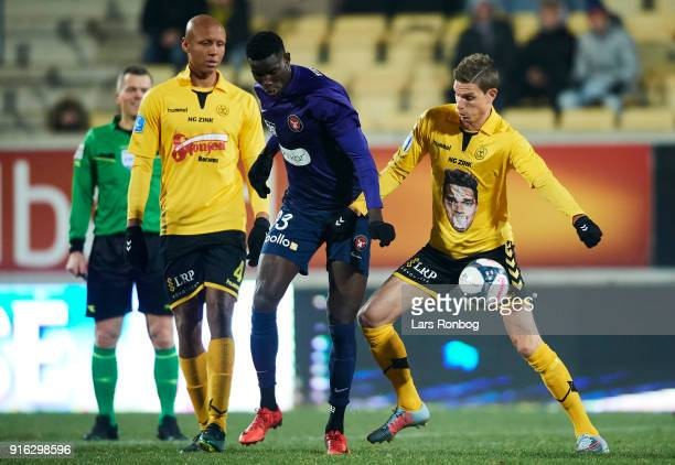 Paul Onuachu of FC Midtjylland and Jonas Borring of AC Horsens compete for the ball during the Danish Alka Superliga match between AC Horsens and FC...