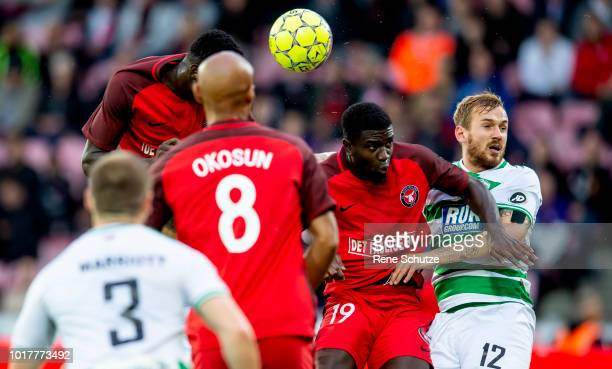 Paul Onuachu of FC Midtjylland and Mayron George of FC Midtjylland in fight for the ball with Blaine Hudson of New Saints FC in the UEFA Europa...