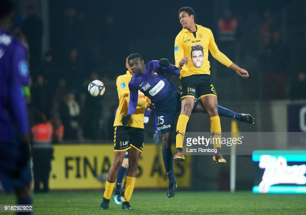 Paul Onuachu of FC Midtjylland and Mikkel Qvist of AC Horsens compete for the ball during the Danish Alka Superliga match between AC Horsens and FC...