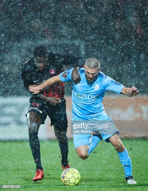 Paul Onuachu of FC Midtjylland and Perry Kitchen of Randers FC compete for the ball during the Danish Alka Superliga match between Randers FC and FC...