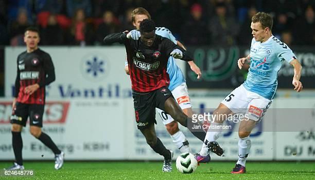Paul Onuachu of FC Midtjylland and Troels Klove of SonderjyskE compete for the ball during the Danish Alka Superliga match between SonderjyskE and FC...