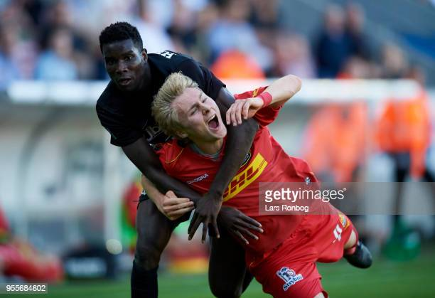 Paul Onuachu of FC Midtjylland and Victor Nelsson of FC Nordsjælland compete for the ball during the Danish Alka Superliga match between FC...
