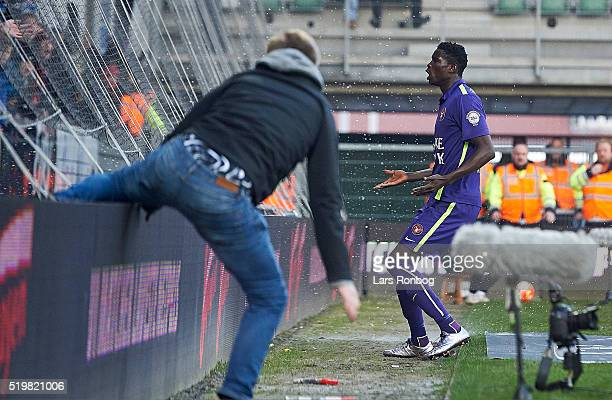 Paul Onuachu of FC Midtjylland celebrates after scoring their first goal while a fan is running on to the pitch during the Danish Alka Superliga...