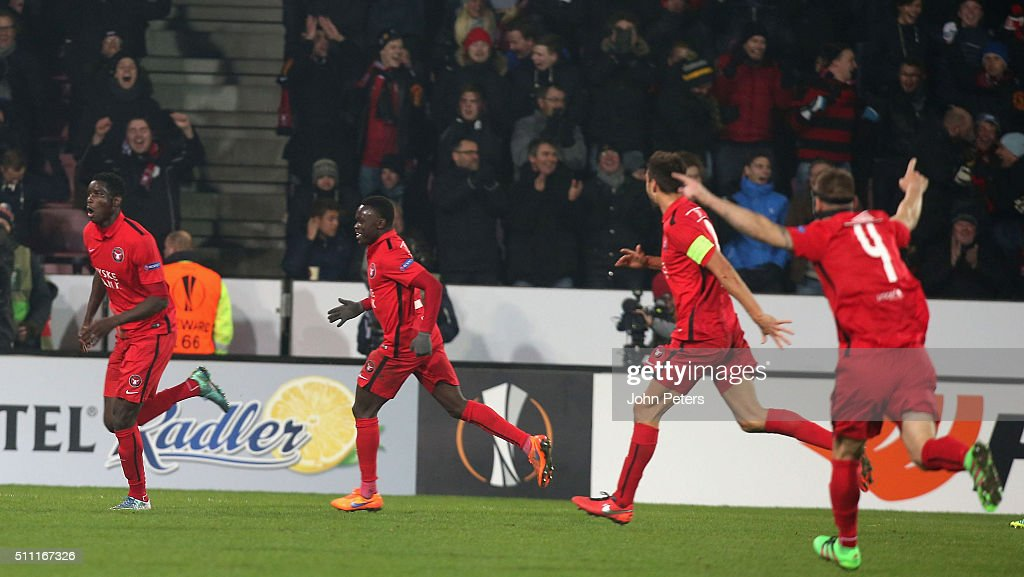 Paul Onuachu of FC Midtjylland (L) celebrates scoring their second goal during the UEFA Europe League match between FC Midtjylland and Manchester United on February 18, 2016 at MCH Arena in Herning, Denmark.