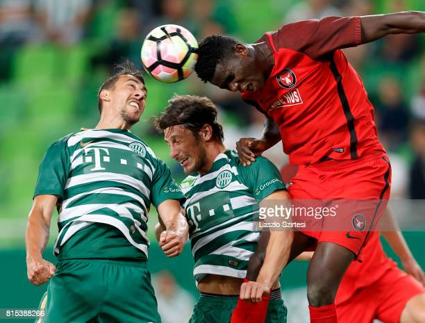 Paul Onuachu of FC Midtjylland competes for the ball in the air with Leandro De Almeida 'Leo' of Ferencvarosi TC and Bence Batik of Ferencvarosi TC...