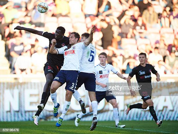 Paul Onuachu of FC Midtjylland Niklas Backman of AGF Arhus and Alexander Juel Andersen of AGF Arhus compete for the ball during the Danish Alka...