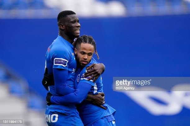 Paul Onuachu of KRC Genk celebrates with Theo Bongonda of KRC Genk after scoring his sides fourth during the Jupiler Pro League match between KRC...