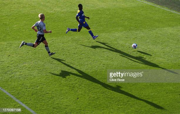 Paul Osew of AFC Wimbledon and George Lapslie of Charlton Athletic chase the ball during the EFL Trophy match AFC Wimbledon and Charlton Athletic at...