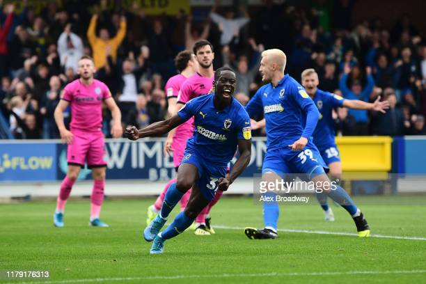 Paul Osew of AFC Wimbledon celebrates scoring his team's second goal during the Sky Bet League One match between AFC Wimbledon and Rochdale at The...