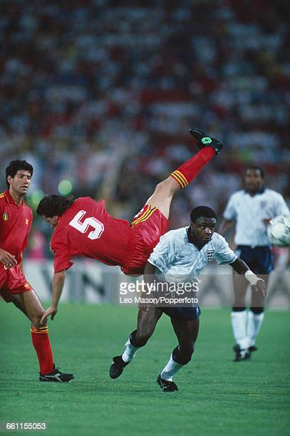 Paul Parker of England turns to avoid a falling Bruno Versavel of Belgium in the 1990 FIFA World Cup last 16 knockout round game between Belgium and...