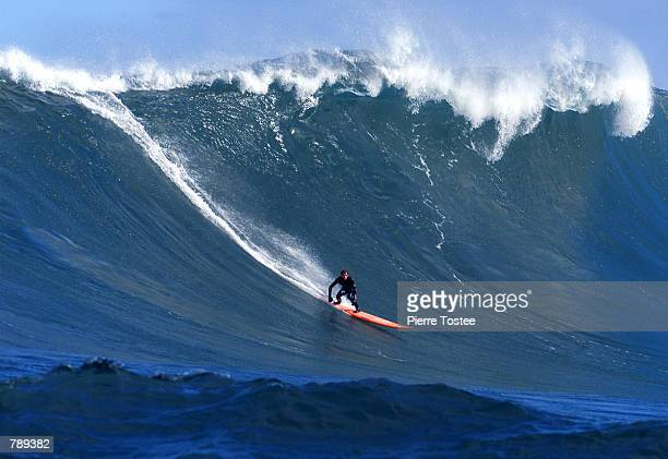 Paul Paterson of Australia catches a five metre wave at Dungeons during a practice session on day nine of the waiting period for the Red Bull Big...