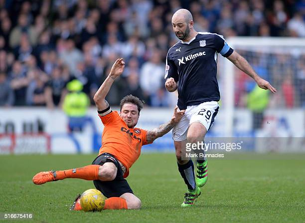 Paul Paton of Dundee United and Gary Harkins of Dundee FC challenge for the ball during the Ladbrokes Scottish Premiership match between Dundee...