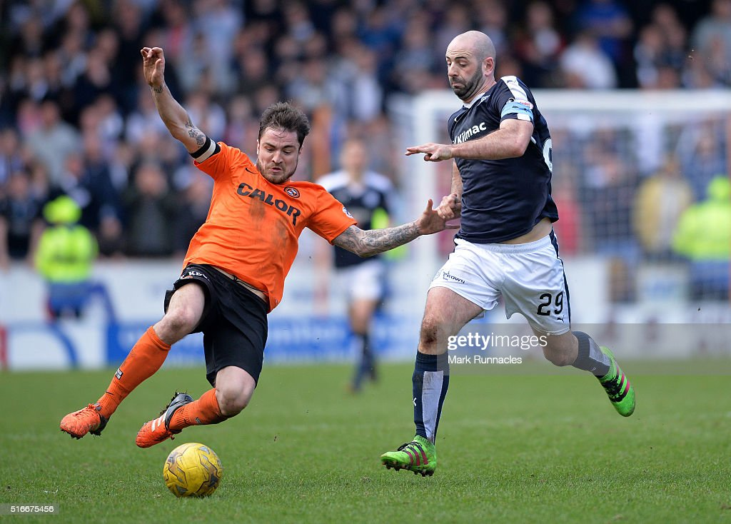 Paul Paton of Dundee United and Gary Harkins of Dundee FC challenge for the ball during the Ladbrokes Scottish Premiership match between Dundee United FC and Dundee FC at Tannadice Park on March 20, 2016 in Dundee, Scotland.