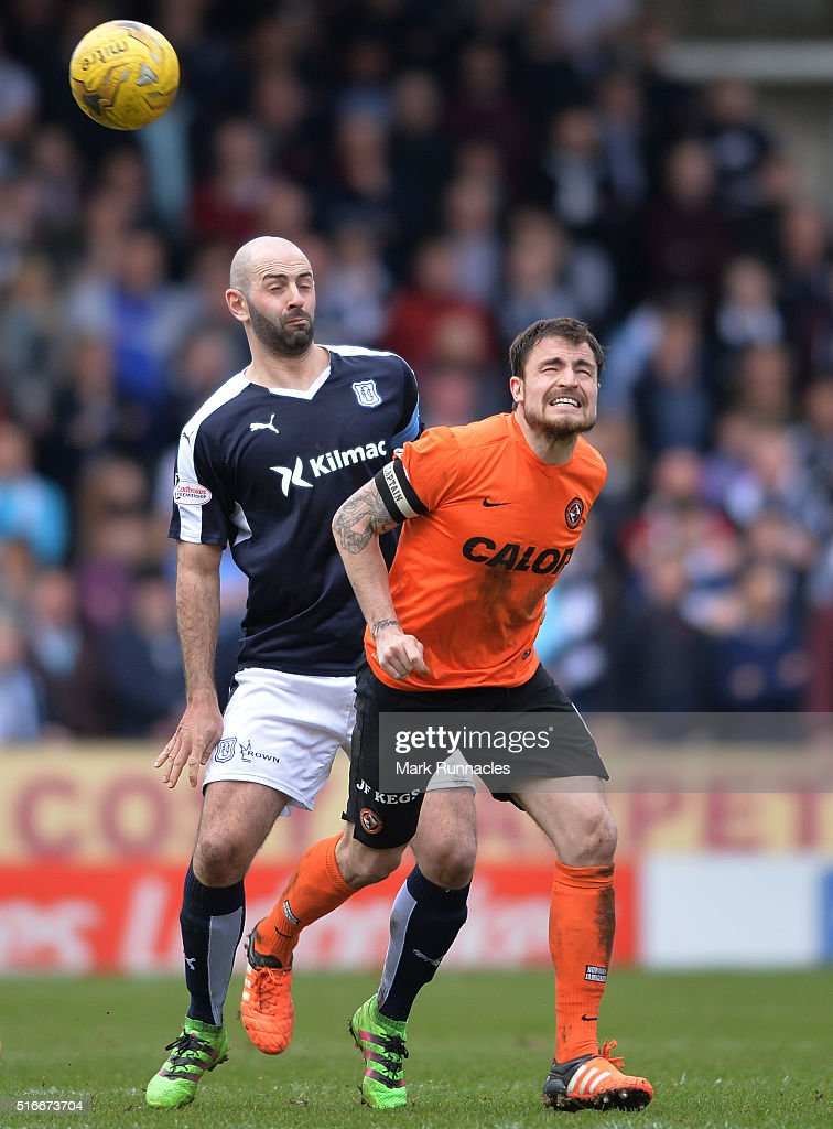 Paul Paton of Dundee United is challenged by Gary Harkins of Dundee during the Ladbrokes Scottish Premiership match between Dundee United FC and Dundee FC at Tannadice Park on March 20, 2016 in Dundee, Scotland.