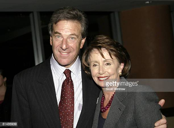 Paul Pelosi and House Democratic Leader Nancy Pelosi pose before the premiere of Diary Of A Political Tourist on October 6 2004 in New York City
