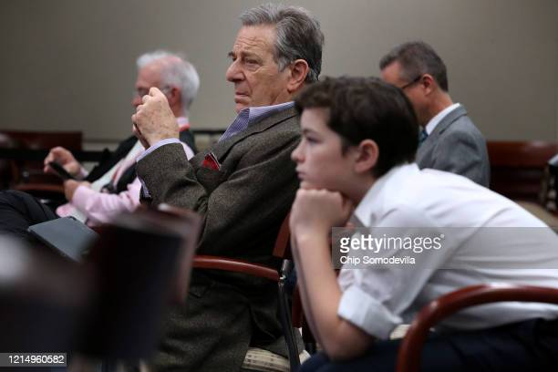 Paul Pelosi husband of US House Speaker Nancy Pelosi and their grandson Thomas Vos listen during a news conference about the ongoing coronavirus...