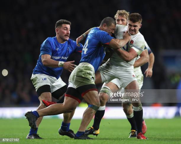 Paul Perez of Samoa is tackled by Henry Slade of England during the Old Mutual Wealth Series match between England and Samoa at Twickenham Stadium on...