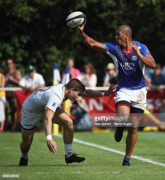 Paul Perez of Samoa passes the ball past Nikolai Klewinghaus of Germany during the Germany v Samoa Rugby World Cup 2019 qualifying match on July 14...