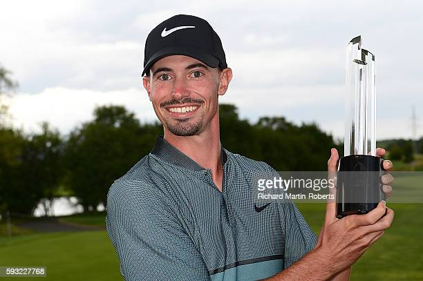 Paul Peterson of the United States poses with the trophy following his victory during the final round of the DD REAL Czech Masters at Albatross Golf...