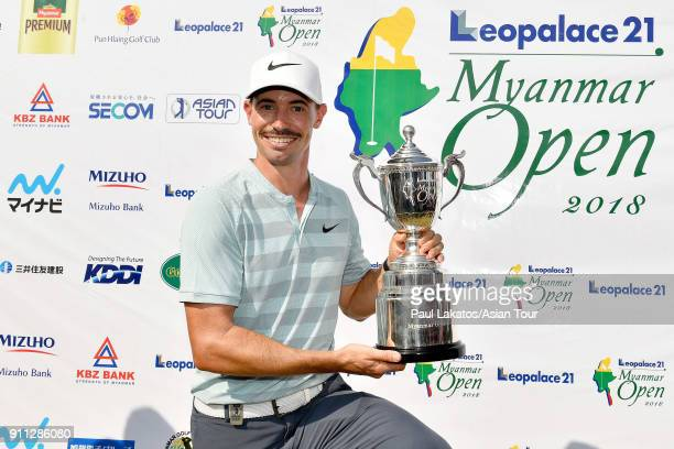 Paul Peterson of the USA pictured with the winner's trophy after round four of the Leopalace21 Myanmar Open at Pun Hlaing Golf Club on January 28,...