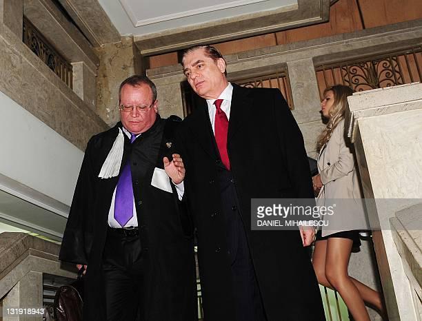 Paul Philippe de Hohenzollern and his lawyer Veronel Radulescu leave Romania's supreme court in Bucharest on November 8 2011 Romania's supreme court...