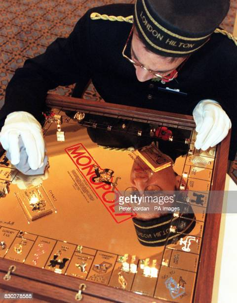 Paul Phillips from Greenford polishing the gold encrusted Monopoly set hand crafted by US celebrity jeweller Sidney Mobell worth $3 million which was...
