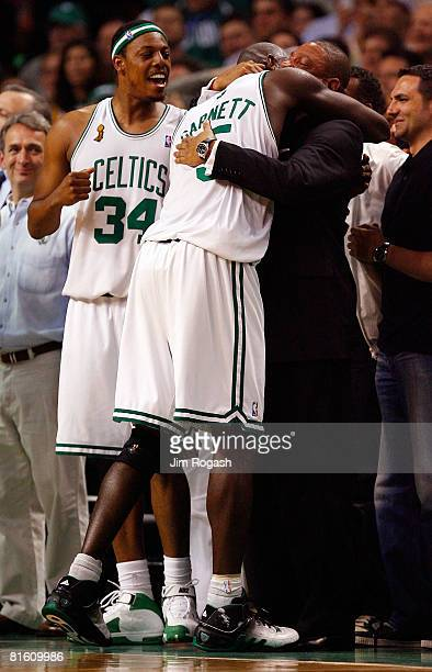 Paul Pierce and Kevin Garnett celebrate with head coach Doc Rivers of the Boston Celtics as the Celtics lead the Los Angeles Lakers in the fourth...