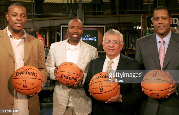 Paul Pierce, Kenny Smith, David Stern and Stu Jackson at a news conference to unveil the new NBA ball at the NBA Store in New York City, New York on...