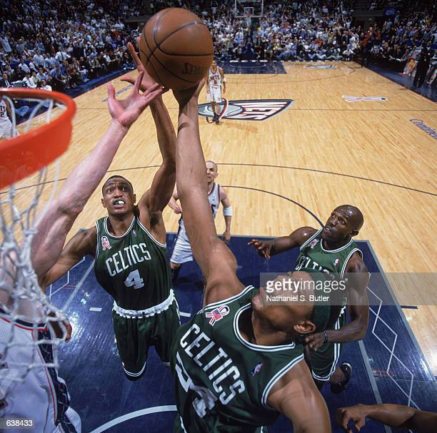 Paul Pierce of the Boston Celtics and his teammate Tony Battie attempt to rebound the ball during game 2 of the Eastern Conference Finals during the...