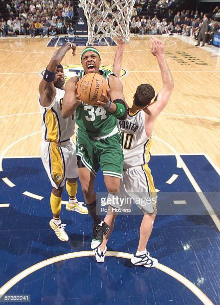 Paul Pierce of the Boston Celtics battles Stephen Jackson and Jeff Foster of the Indiana Pacers on April 12, 2006 at Conseco Fieldhouse in...