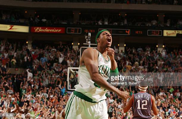 Paul Pierce of the Boston Celtics celebrates a huge comeback against the New Jersey Nets during Eastern Conference Final game 3 at the FleetCenter in...