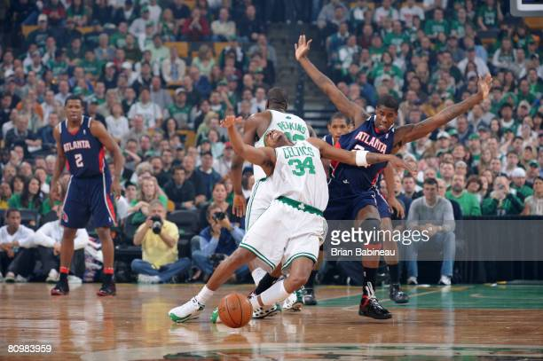 Paul Pierce of the Boston Celtics collides with Marvin Williams of the Atlanta Hawks chasing loose ball in Game Seven of the Eastern Conference...