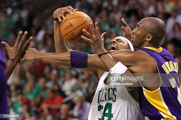 Paul Pierce of the Boston Celtics draws contact as he drives against Kobe Bryant of the Los Angeles Lakers during the second half of Game Five of the...