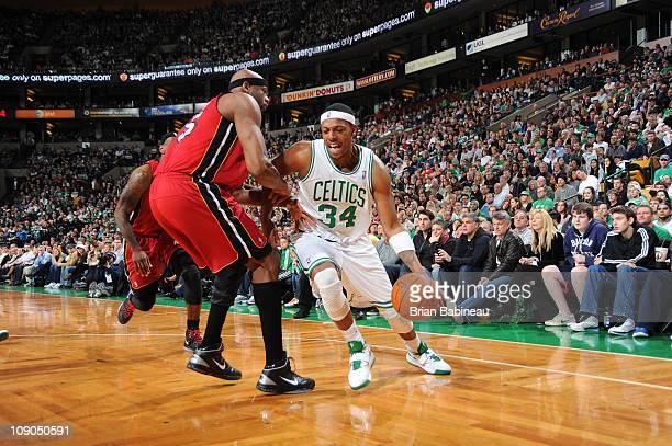 Paul Pierce of the Boston Celtics drives against Erick Dampier of the Miami Heat on February 13 2011 at the TD Garden in Boston Massachusetts NOTE TO...