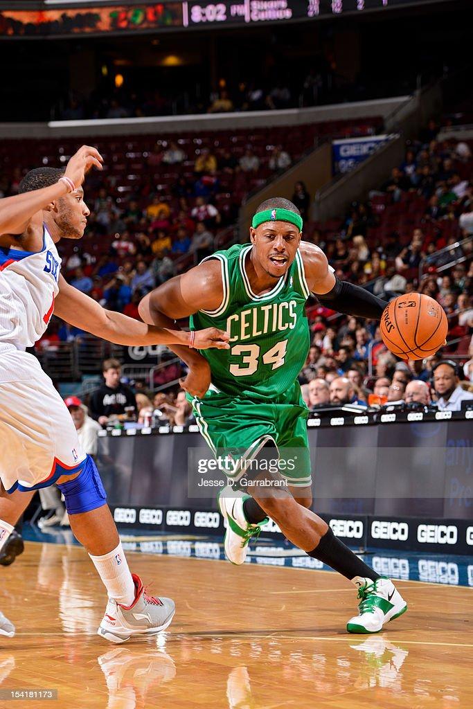 Paul Pierce #34 of the Boston Celtics drives against Evan Turner #12 of the Philadelphia 76ers during a pre-season game at the Wells Fargo Center on October 15, 2012 in Philadelphia, Pennsylvania.