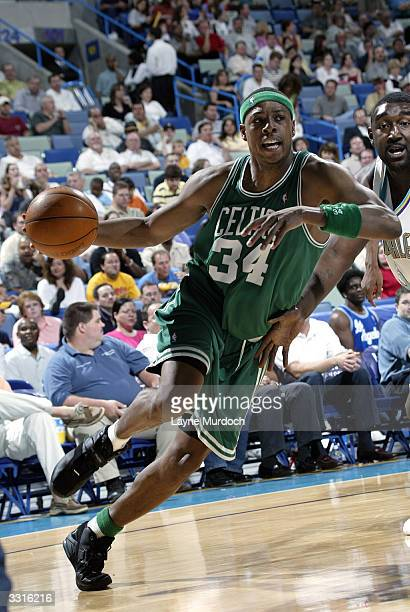 Paul Pierce of the Boston Celtics drives around Robert Traylor of the New Orleans Hornets April 9 2004 at the New Orleans Arena in New Orleans...
