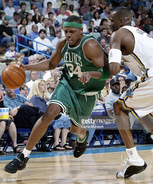 Paul Pierce of the Boston Celtics drives around Stacey Augmon of the New Orleans Hornets April 9 2004 at the New Orleans Arena in New Orleans...
