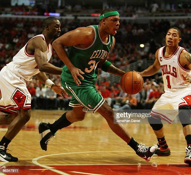 Paul Pierce of the Boston Celtics drives between Ben Gordon and Derrick Rose of the Chicago Bulls in Game Six of the Eastern Conference Quarterfinals...