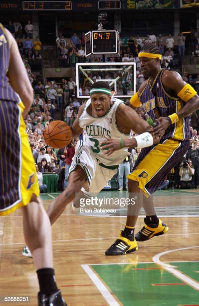Paul Pierce of the Boston Celtics drives by Stephen Jackson of the Indiana Pacers in Game one of the Eastern Conference Quarterfinals during the 2005...